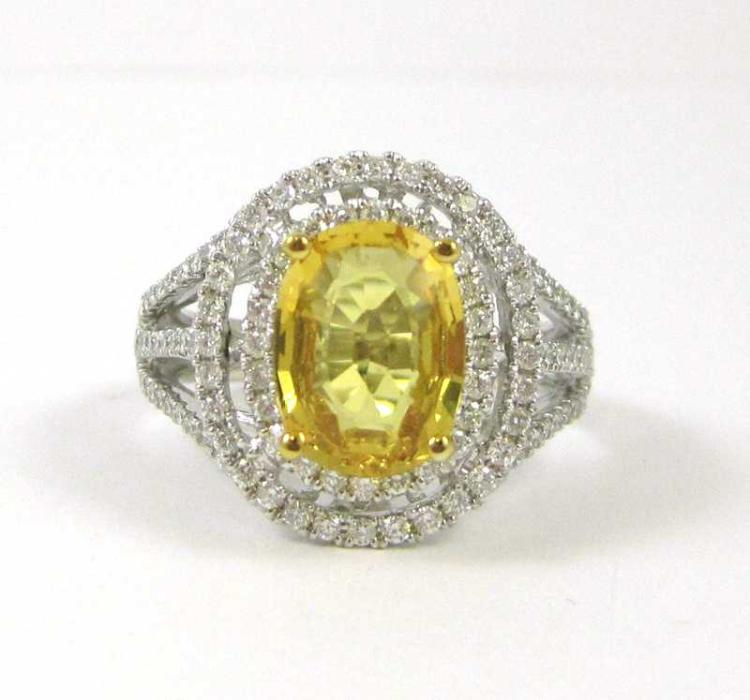 YELLOW SAPPHIRE AND FOURTEEN KARAT WHITE GOLD RING