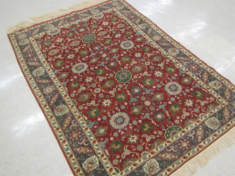 SEMI-ANTIQUE TURKISH AREA RUG, hand knotted in an