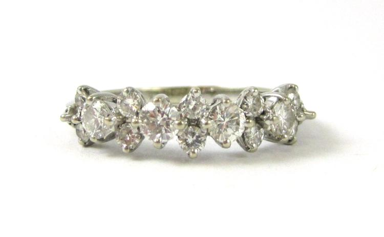 DIAMOND AND EIGHTEEN KARAT WHITE GOLD RING, set wi