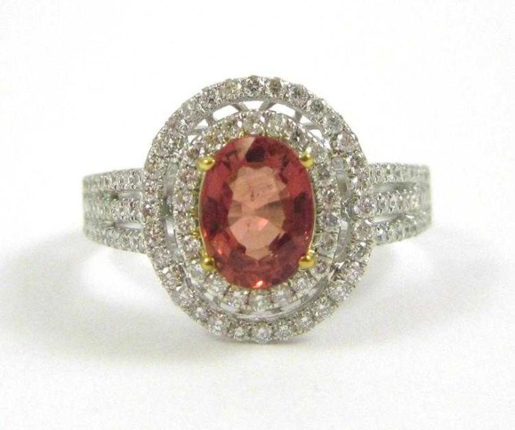 ORANGE SAPPHIRE AND FOURTEEN KARAT GOLD RING.  The