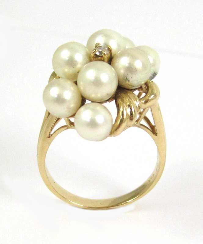 PEARL, DIAMOND AND FOURTEEN KARAT GOLD RING, set w