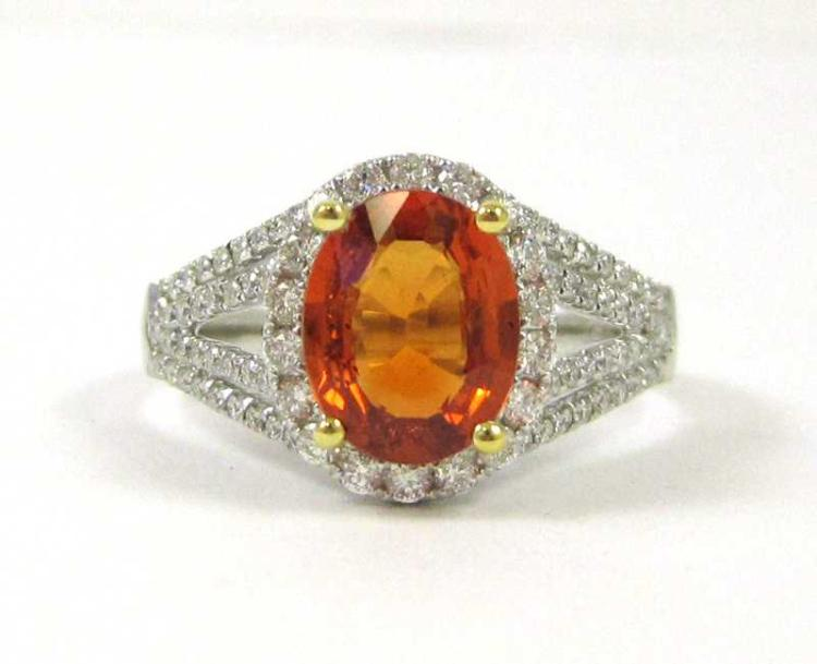 ORANGE SAPPHIRE, DIAMOND AND EIGHTEEN KARAT GOLD R