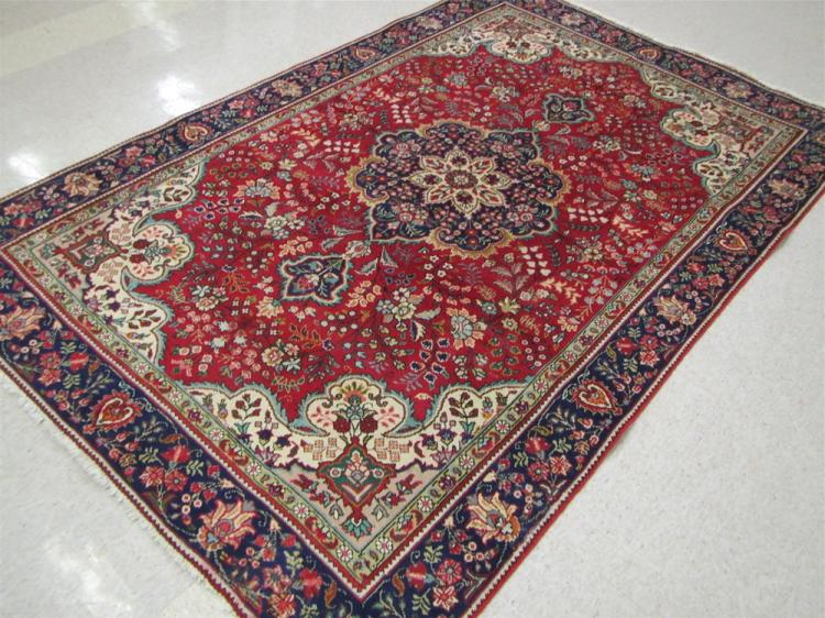 HAND KNOTTED PERSIAN CARPET, floral and central fl