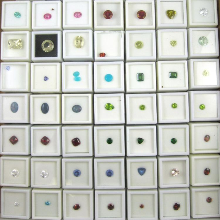 COLLECTION OF SIXTY UNSET GEMSTONES, including (3)
