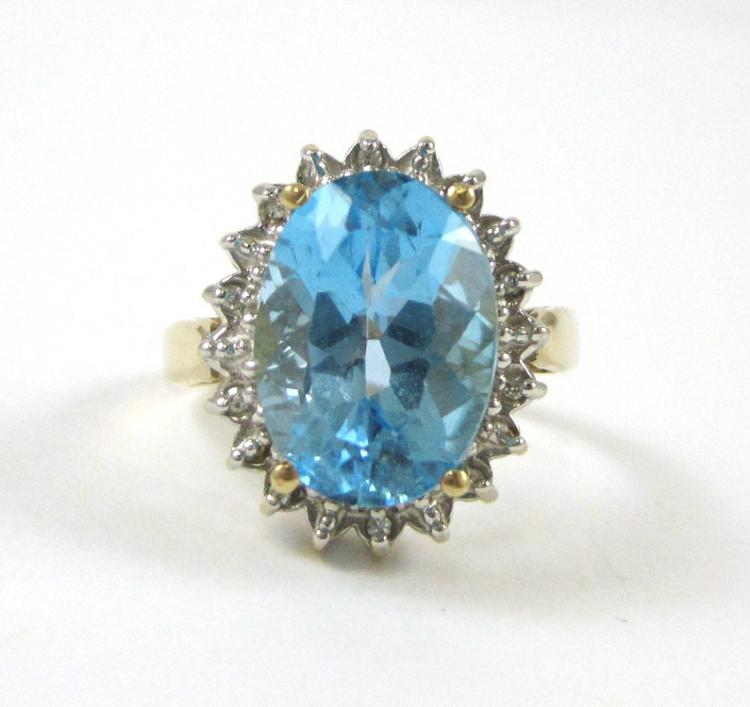 BLUE TOPAZ, DIAMOND AND FOURTEEN KARAT GOLD RING,