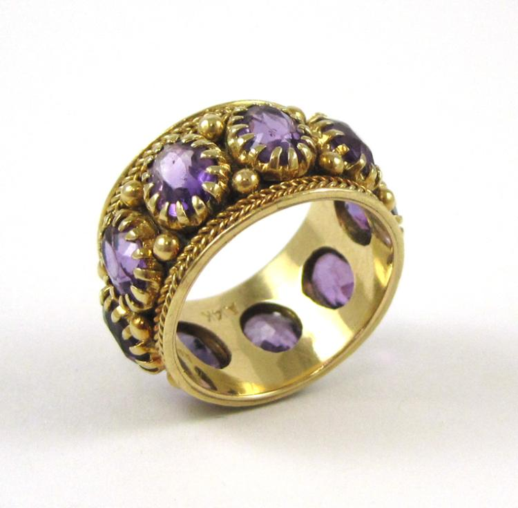 AMETHYST AND FOURTEEN KARAT GOLD RING, set with ni