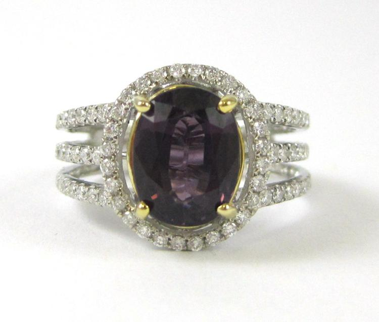 PURPLE SPINEL AND FOURTEEN KARAT GOLD RING.  The w