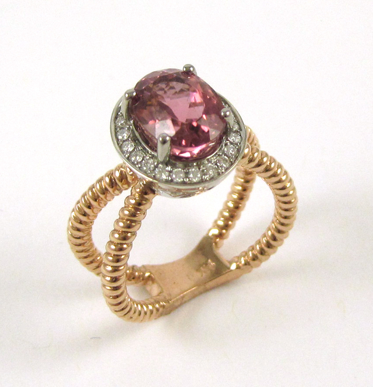 PINK TOURMALINE AND FOURTEEN KARAT GOLD RING.  The