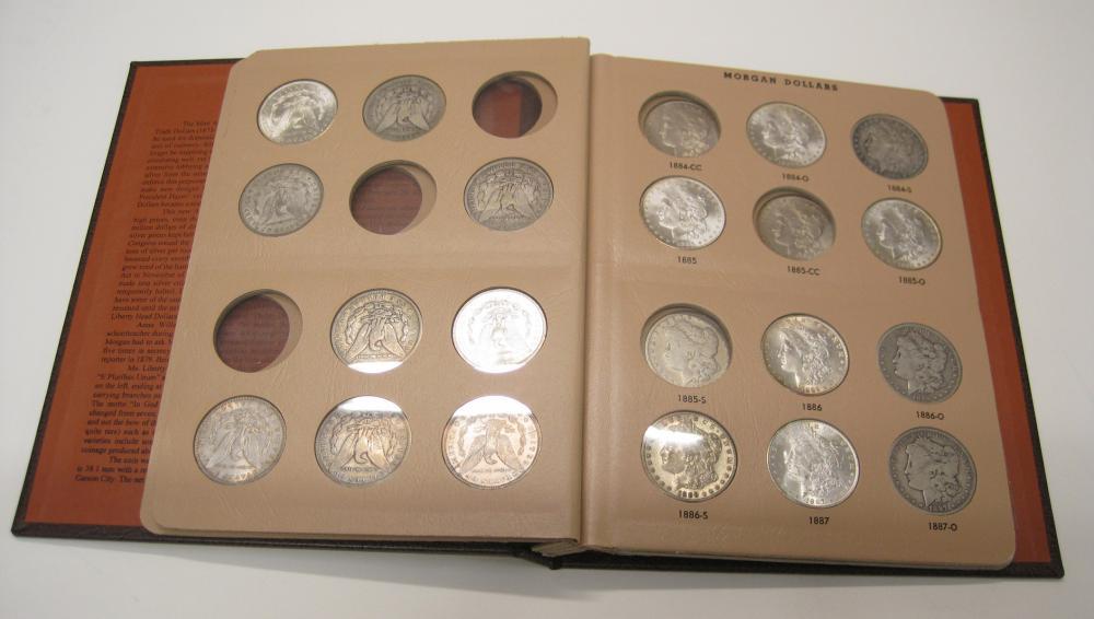 ALBUM OF THIRTY-TWO U.S. SILVER MORGAN DOLLARS: 1