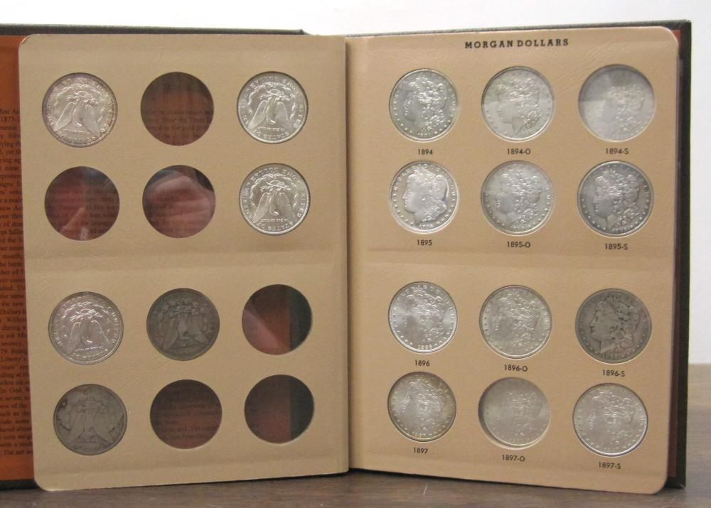 ALBUM OF THIRTY-NINE U.S. SILVER MORGAN DOLLARS: