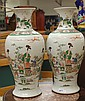 PAIR OF CHINESE FAMILLE ROSE VASES having baluster