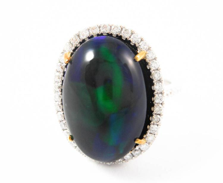 BLACK OPAL, DIAMOND AND FOURTEEN KARAT GOLD RING.