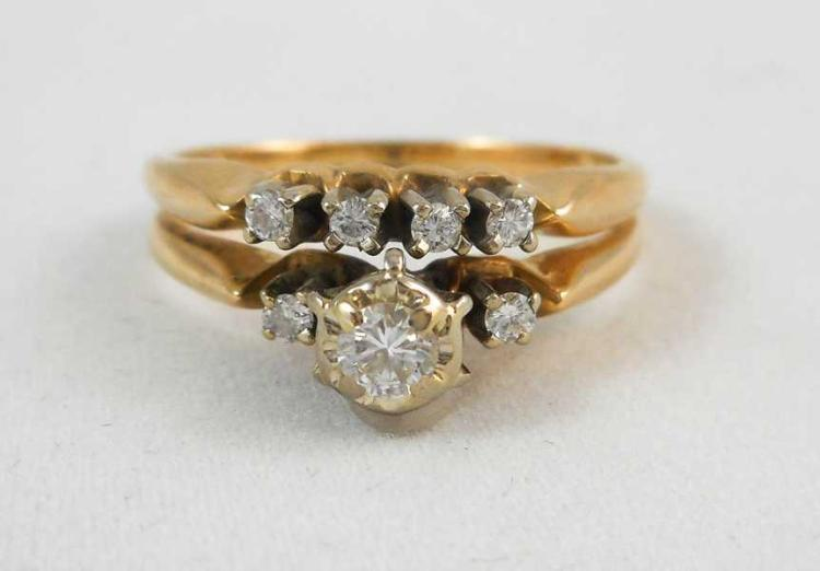 DIAMOND AND FOURTEEN KARAT GOLD RING, featuring ar