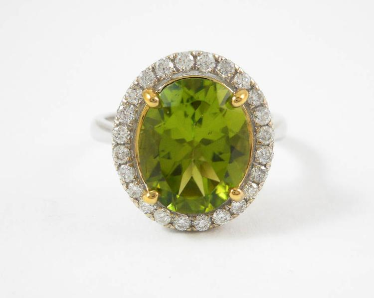 PERIDOT, DIAMOND AND FOURTEEN KARAT GOLD RING. Th