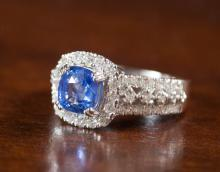 SAPPHIRE, DIAMOND AND FOURTEEN KARAT GOLD RING, wi