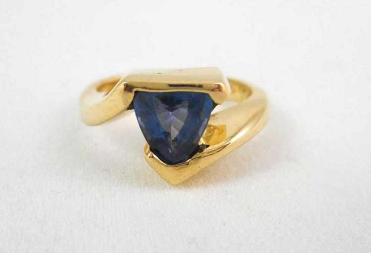 IOLITE AND FOURTEEN KARAT GOLD RING, set with a si