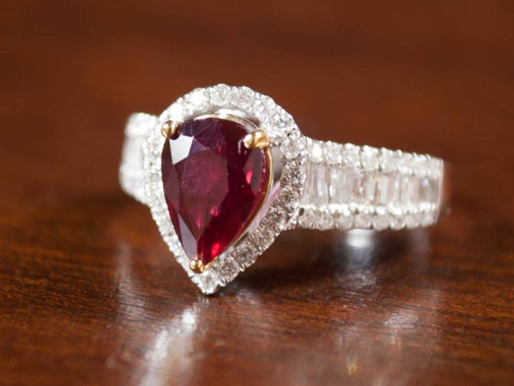 RUBY, DIAMOND AND FOURTEEN KARAT GOLD RING, with A
