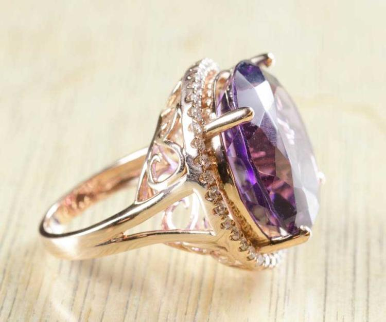 AMETHYST, DIAMOND AND ROSE GOLD RING. The 14k ros