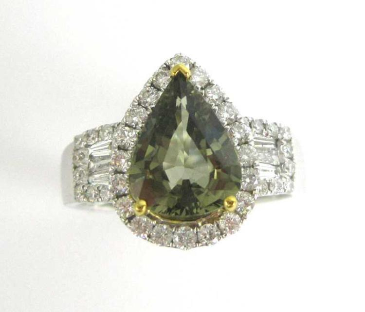 GREEN COLOR CHANGE SAPPHIRE AND DIAMOND RING, with