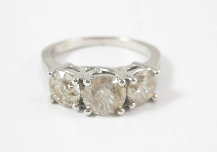 THREE STONE DIAMOND AND WHITE GOLD RING.  The 14k