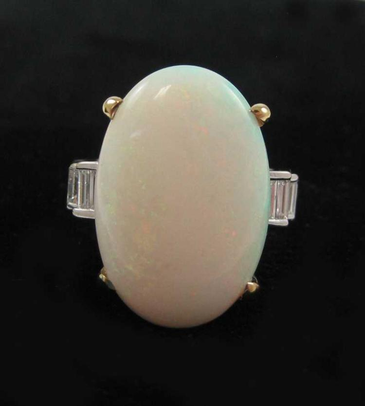 OPAL, DIAMOND AND FOURTEEN KARAT GOLD RING.  The w