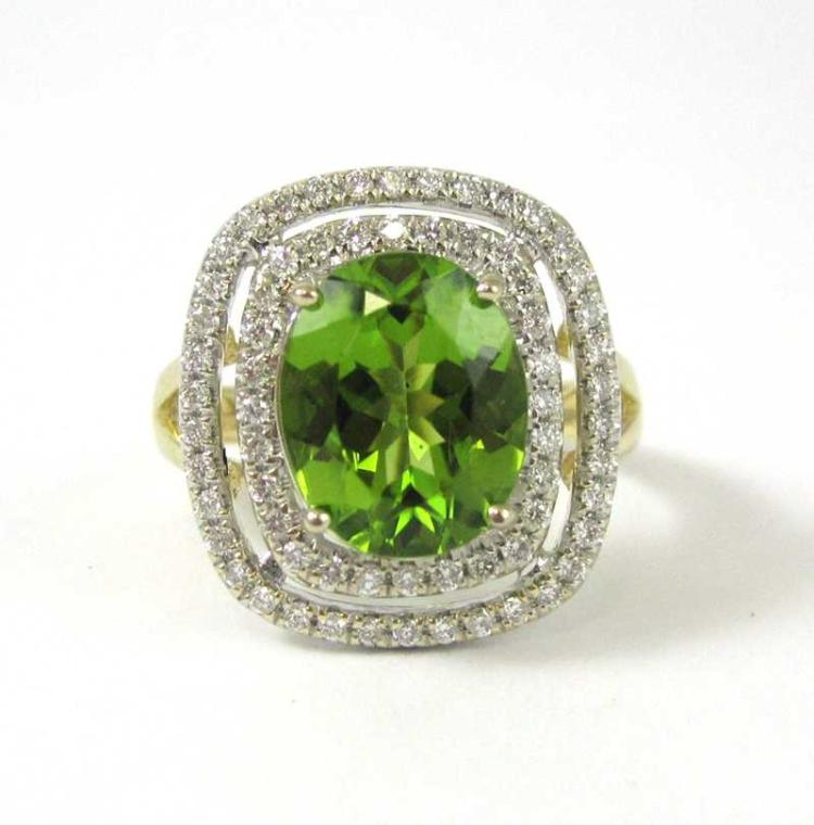 PERIDOT, DIAMOND AND FOURTEEN KARAT GOLD RING.  Th