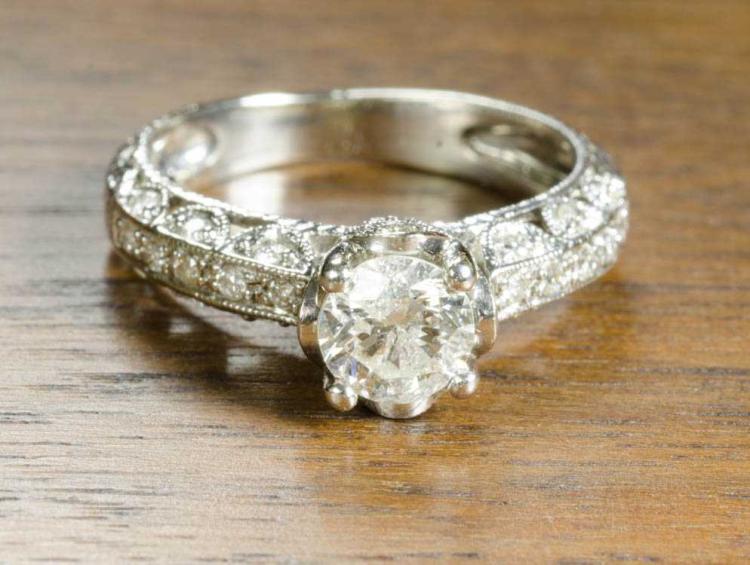 DIAMOND AND FOURTEEN KARAT WHITE GOLD RING, the fi