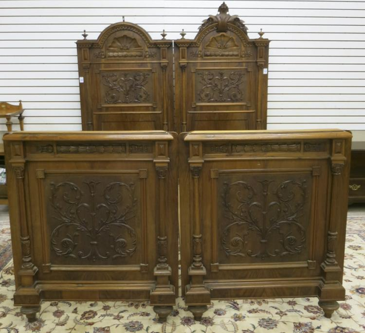 A PAIR OF CARVED WALNUT HIGH BACK TWIN BEDS, Austr