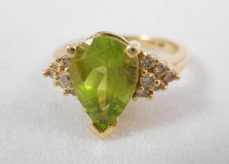 PERIDOT, DIAMOND AND FOURTEEN KARAT GOLD RING, wit