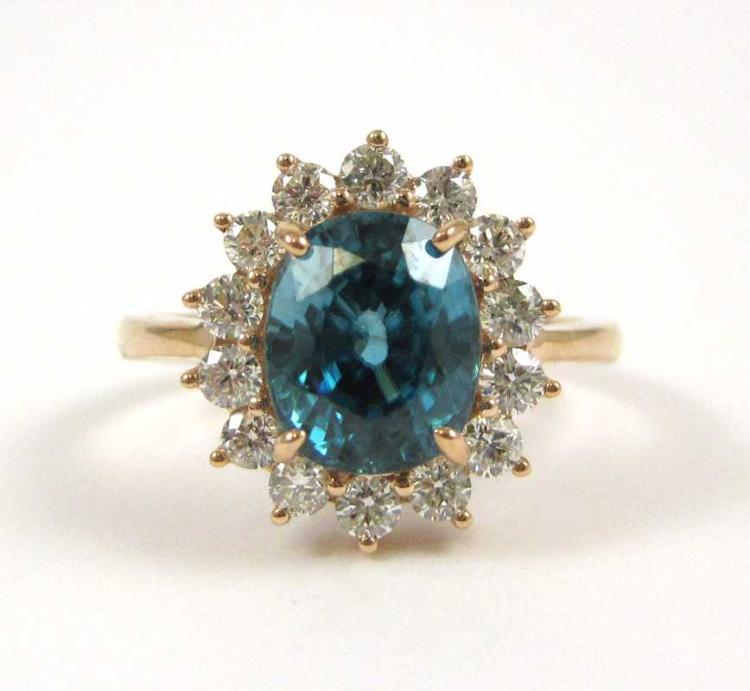 ZIRCON, DIAMOND AND FOURTEEN KARAT GOLD RING.  The