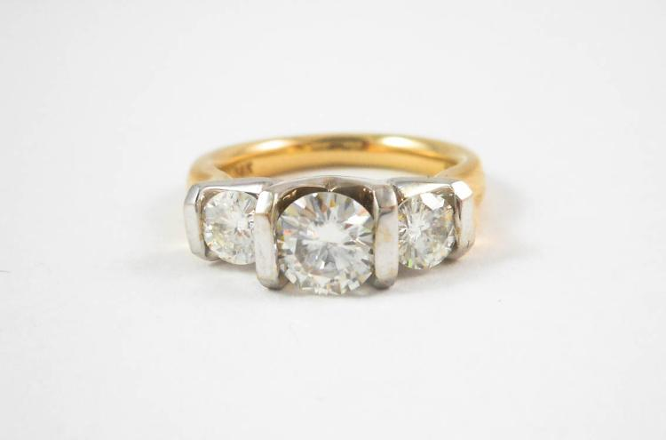 MOISSANITE AND FOURTEEN KARAT GOLD RING.  The yell