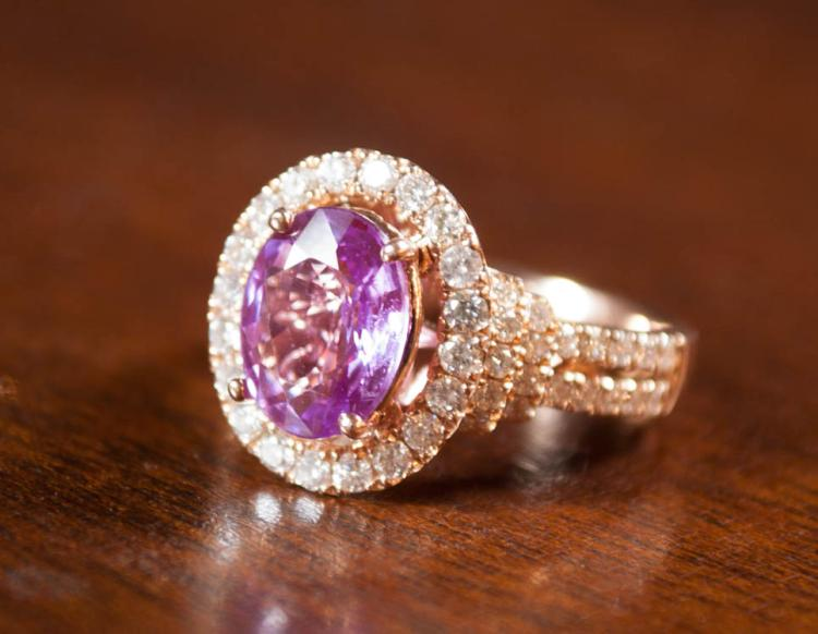 RHODOLITE, DIAMOND AND FOURTEEN KARAT GOLD RING.