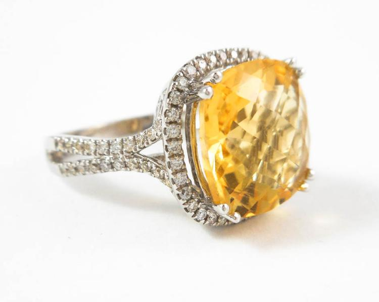 CITRINE, DIAMOND AND FOURTEEN KARAT GOLD RING. Th