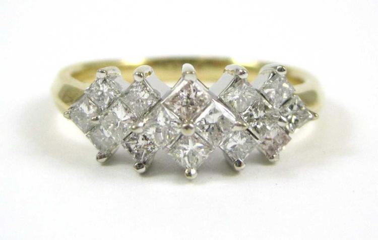 DIAMOND AND FOURTEEN KARAT GOLD RING.  The yellow