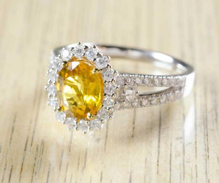 YELLOW SAPPHIRE AND FOURTEEN KARAT GOLD RING.  The