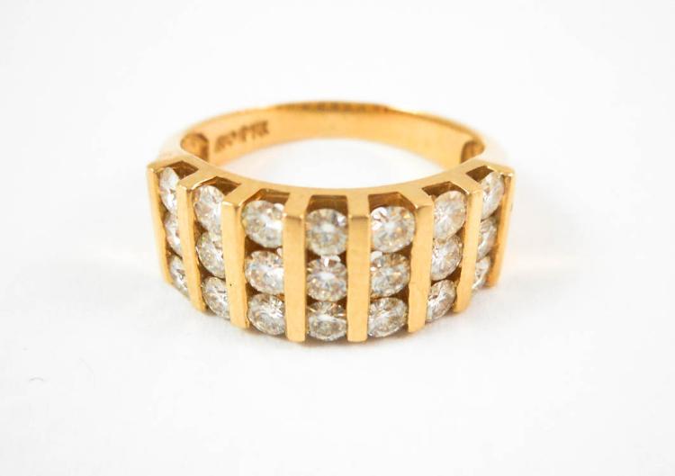 MOISSANITE AND FOURTEEN KARAT GOLD RING, set with