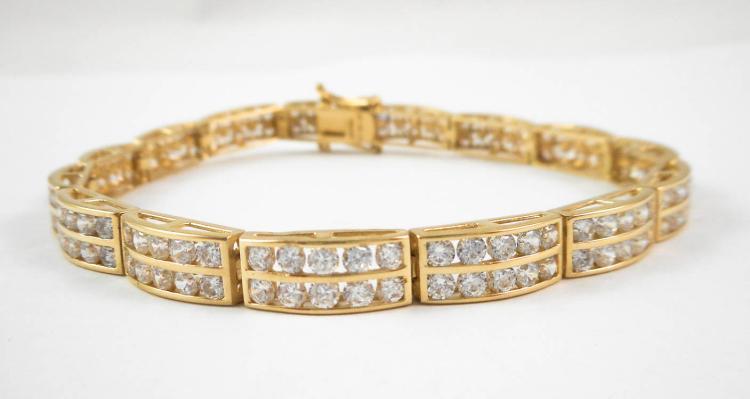 DIAMONIQUE FOURTEEN KARAT GOLD BRACELET, measuring