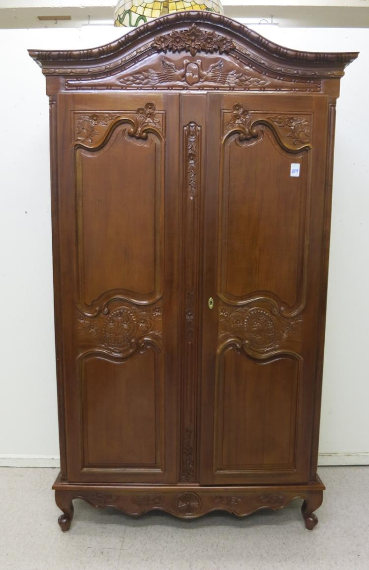 LOUIS XV STYLE CARVED MAHOGANY ARMOIRE, having an
