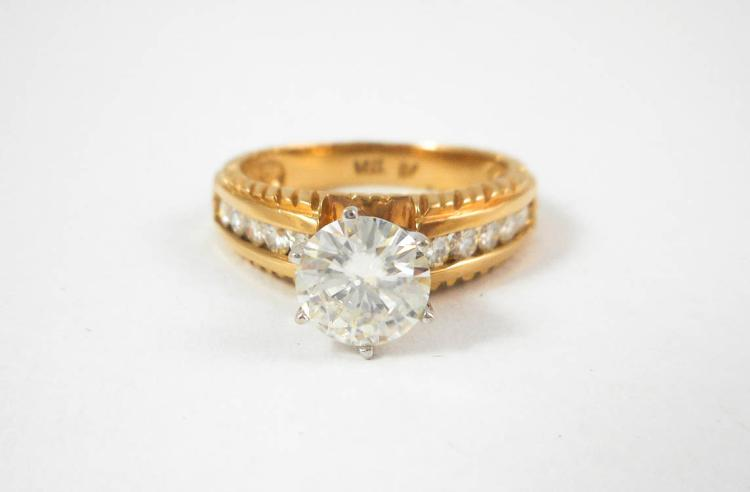 MOISSANITE AND FOURTEEN KARAT GOLD RING, with five