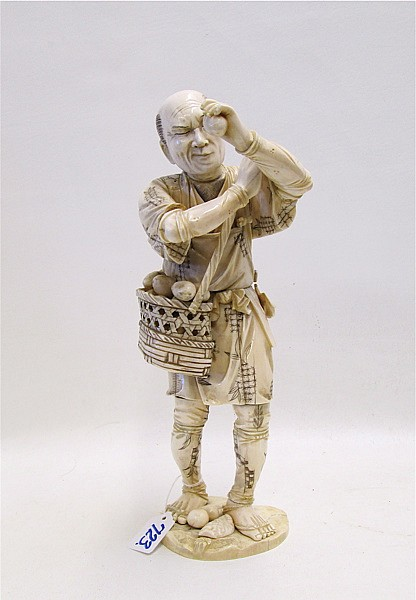 JAPANESE IVORY OKIMONO, man standing with one hand