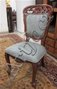 A SET OF SIX CARVED MAHOGANY DINING CHAIRS, each