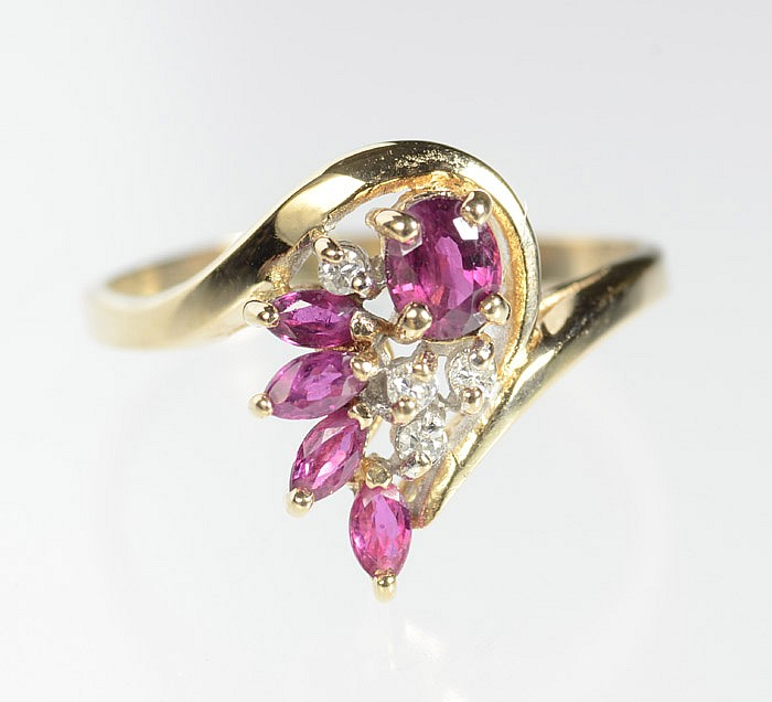 RUBY, DIAMOND AND FOURTEEN KARAT GOLD RING, set