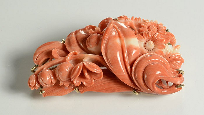 LARGE CARVED PINK CORAL BROOCH. The carved coral