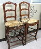 A PAIR OF PROVINCIAL STYLE LADDER-BACK BAR STOOLS,