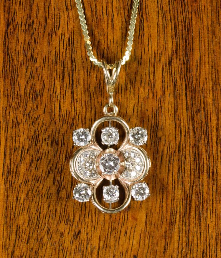 DIAMOND AND FOURTEEN KARAT GOLD PENDANT NECKLACE,