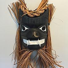Patrick Amos, Nuu-chah-nulth- a carved, cedar black bear mask.