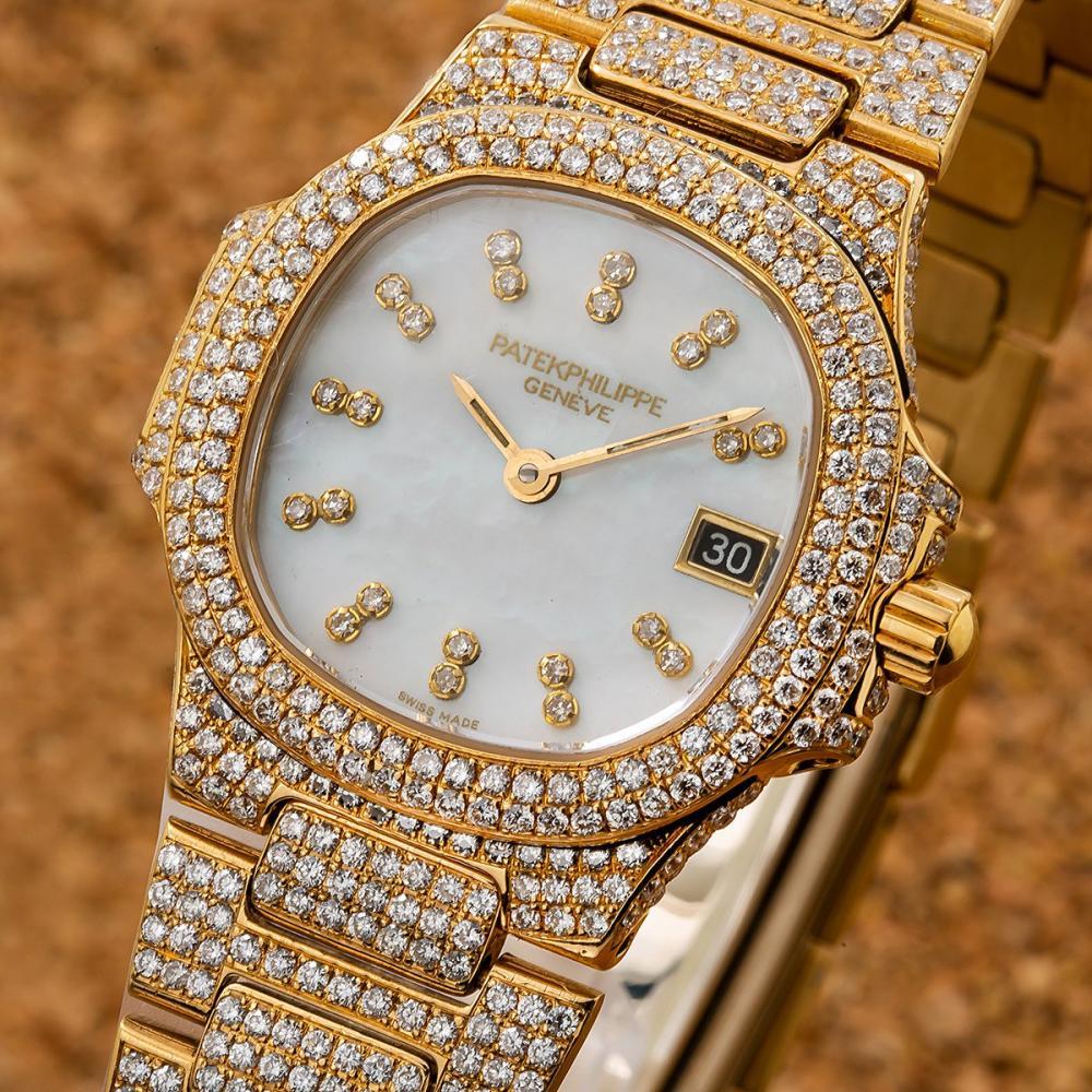 PATEK PHILIPPE 27MM WHITE DIAMOND DIAL WITH 11.75 CT DIAMONDS