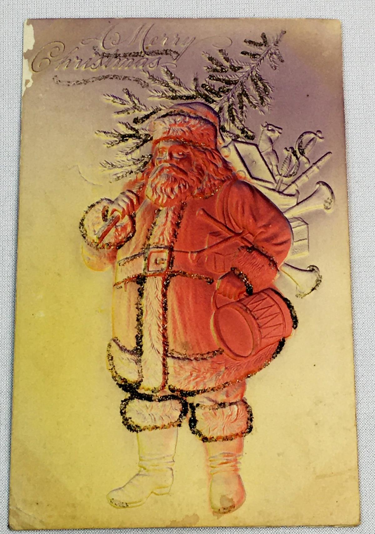 Antique c. 1905 Santa Claus Holding Tree and Sack of Toys Embossed and Glitter Post Card