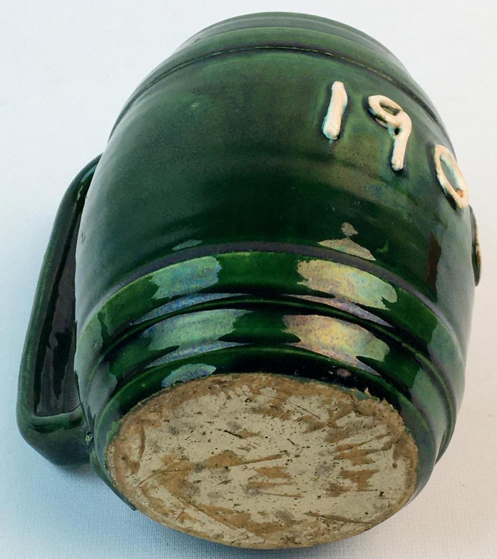 Antique 1906 Relief Green Stoneware Figural Barrel Mug