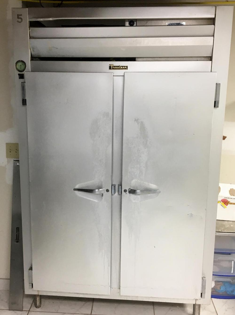 """Traulsen 53"""" Commercial Two Section Solid Door Reach-In Refrigerator with Left / Right Hinged Doors"""
